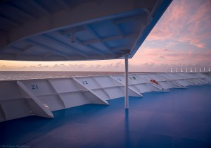 Peaceful view of ocean on quiet curise ship deck.